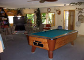 Play a game of pool in the Balsam Beach Resort lodge on Lake Plantagenet.